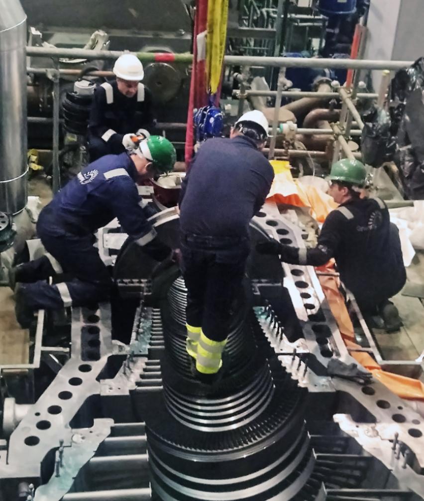 Engineers working on a turbine